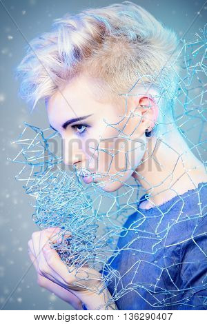 Fashionable designer collection with the use of metal wire. Avant-garde style. Futurism. Studio shot.