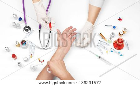Nurse taking a blood sample close up