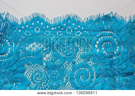 blue lace lying on a white background