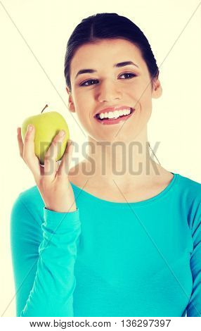 Young casual woman holding an apple.
