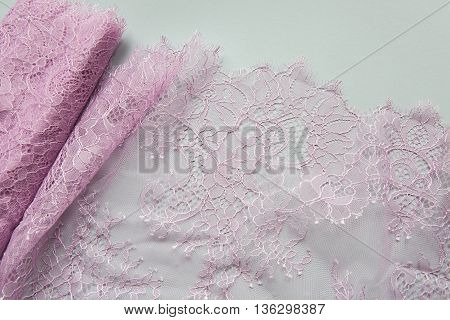 pink lace lying on a white background