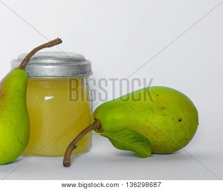 Two pears and pear juice in vintage glass jar