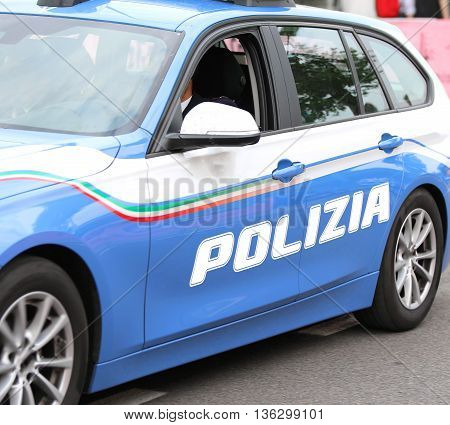 Italian Police Car With Written Polizia Patrols The Streets