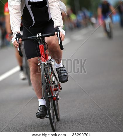 Biker With Windproof Jacket During The Cycling Race In The City