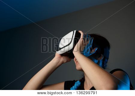 Woman using the virtual reality headset. VR concept