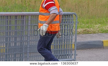 Worker With Reflective Jacket Moves Iron Hurdles
