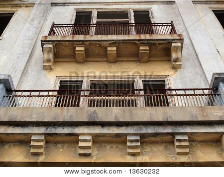 Balconies Of A Old Worn Building