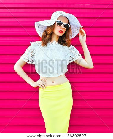 Woman In White Summer Straw Hat And Skirt Over Colorful Pink Background