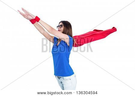 Woman in superhero costume pretending to fly on white background