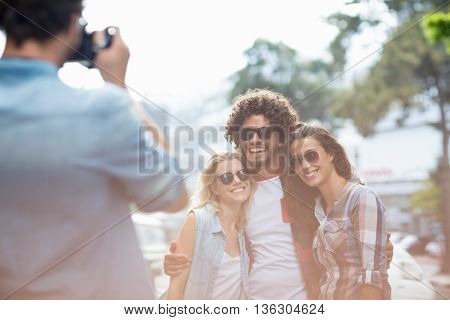 Man taking photo of his friends outdoors