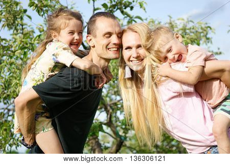 Outdoor portrait of big happy family smiling