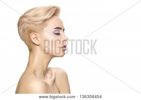 Beautiful portrait of a young girl with white and short hair on a white background.