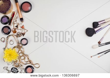 Women's accessories and cosmetics. Top view photo of colorful and glamour objects with free space for logo. There are makeup brushes