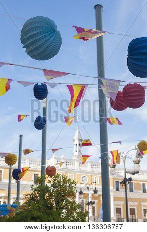 Badajoz Town Hall building between paper lanterns during San Juan Festivities Fair