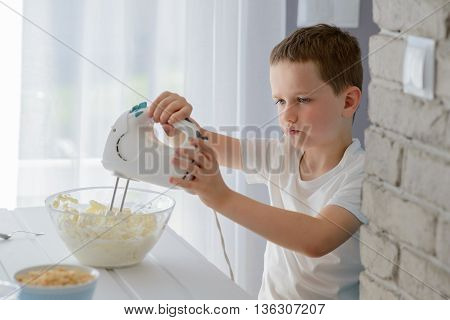 Child Mixing With Electric Mixer White Cottage Cheese