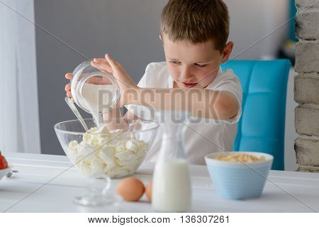 Child Adding Sugar To Cottage Cheese In A Bowl.