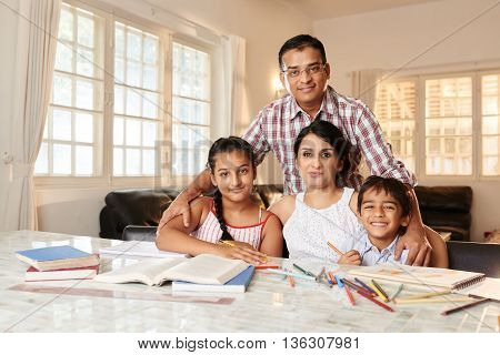 Portrait of Indian parents and children at home