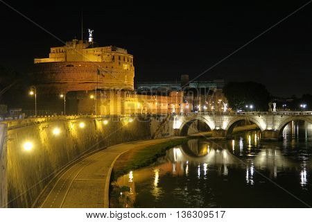 Rome Castel Sant'Angelo night view with St. Angelo Bridge on Tiber river. Ponte Sant'Angelo pedestrian bridge in Rome Italy summer view.