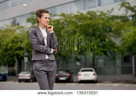 Pensive Business Woman At The Modern Office District
