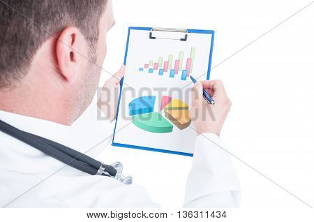 Back Of Medic Analyzing Charts Or Statistics