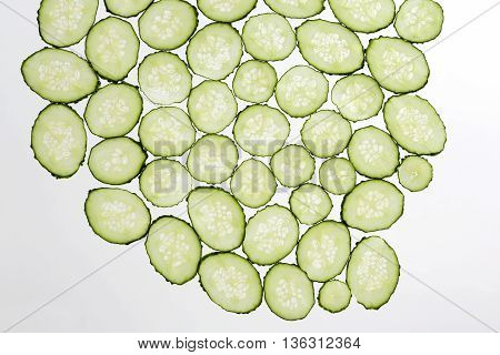 cut thin slices of cucumber on a transparent white background