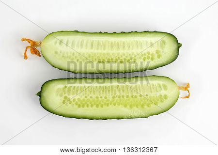 cut lengthwise the cucumber on the white background
