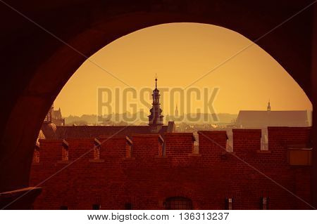 view of Krakow at sunset with silhouettes of buildings