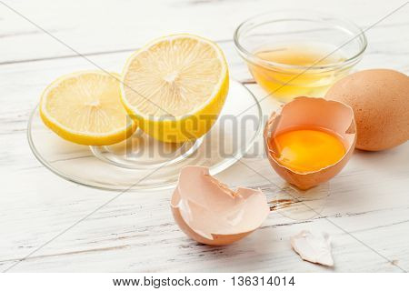 ingredients for homemade food and cosmetics,eggs,lemon, and honey