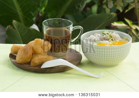 Breaksfast Asian Style / chinese porridge rice grueldeep fried dough stick with Coffee
