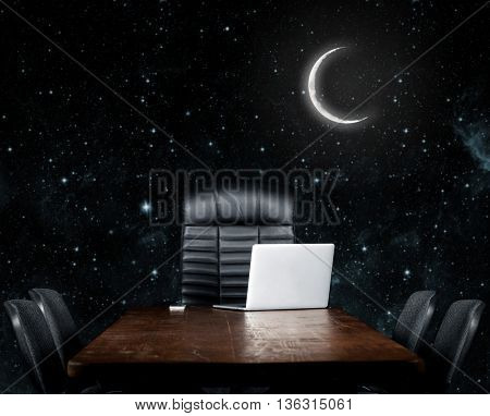 blank desktop on a black background. Elements of this image furnished by NASA