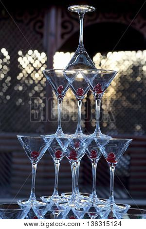 many of the champagne glasses stacked on top of each other