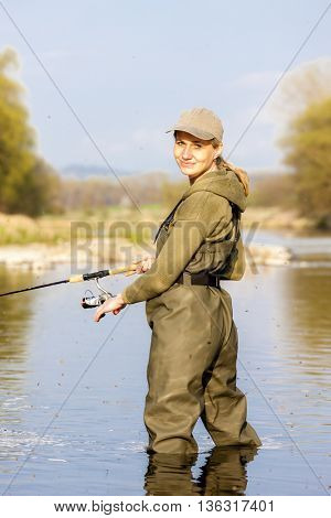 woman fishing in the river
