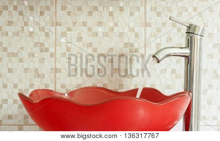 red modern sink with water tap pouring