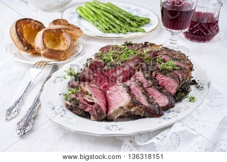 Porterhouse Steak with Yorkshire and Green Asparagus on Plate