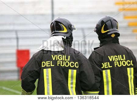 Two Italian Firefighters With The Written Firefighters Do The Security Service