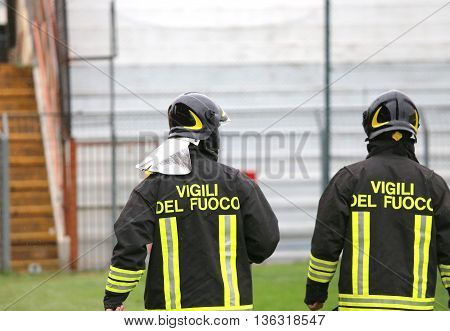 Two Italian Firefighters With Uniform With The Written Firefighters Do The Security Service