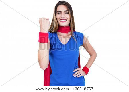 Portrait of cheerful woman in superhero costume while standing on white background