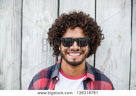 Portrait of happy young man in sunglasses