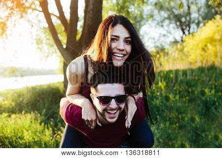 Young beautiful couple having fun in the nature of the countryside