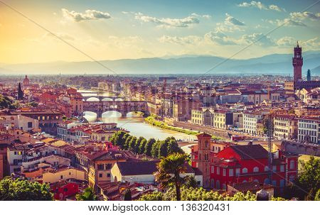 River arno florence with bridge ponte vecchio and roofs of old town sunset view