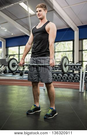 Man lifting a heavy barbell in gym