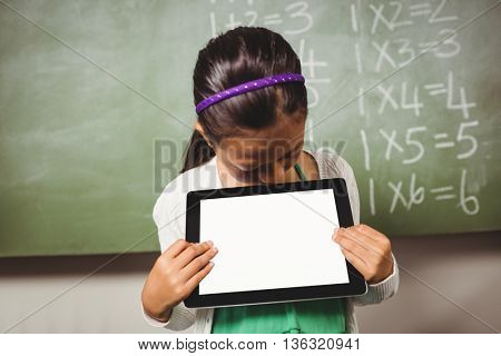 Girl holding a tablet at school