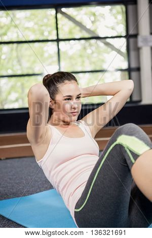 Woman doing abdominal crunches in gym