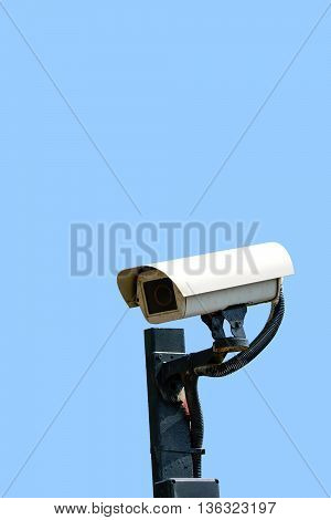 Security cameras (CCTV) or surveillance camera on pole isolated on blue background.