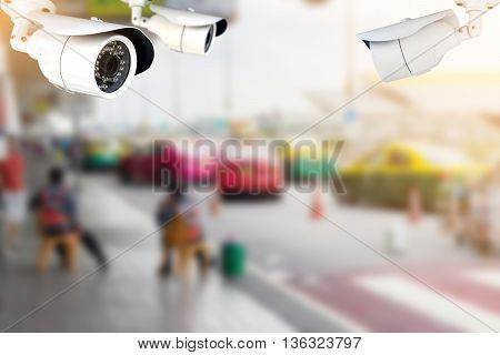 CCTV or surveillance camera recording of traffic in the parking lot for taxis carry passengers inside the departure hall of  the airport.