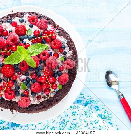 Summer cake with fresh berries. Chocolate cake. Biscuit.