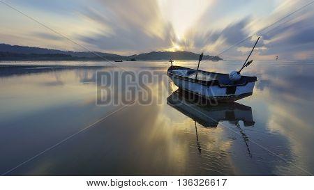 fisherman boat at beach on sunrise at beach