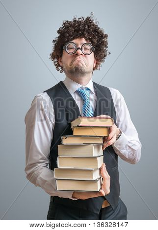 Funny Freak Nerd Professor Holds Many Books In Hands.