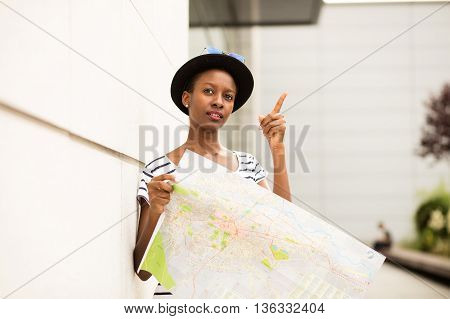 Young Balck Woman Looking Into A Map