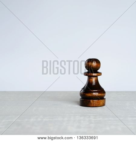Black Pawn On A White Table